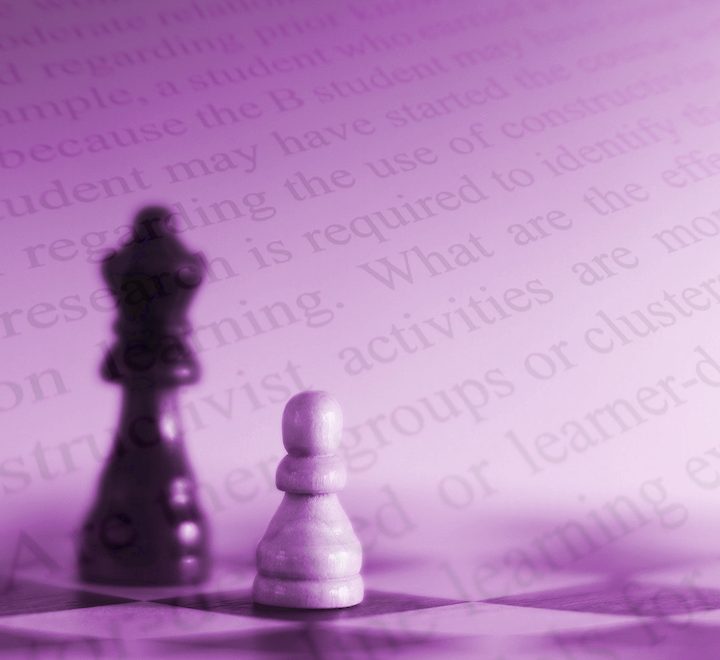 Chess pieces and academic text
